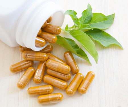 herb capsules spilling out of a bottle 版權商用圖片 - 49936142