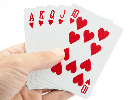 jack of diamonds: playing cards in hand isolated on white background Stock Photo