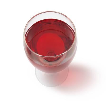 party wine: glass of red wine with shadow top view