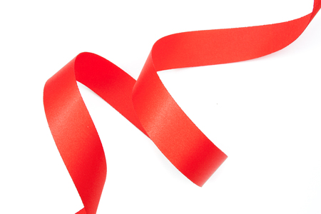 solated on white: red ribbon serpentine solated on white background