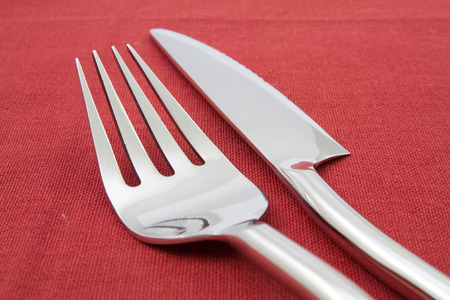 red tablecloth: fork and knife  on red tablecloth