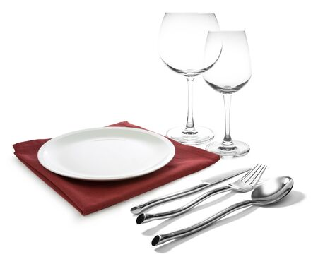 fork glasses: fork and knife on red napkin and wine glasses isolated on white background