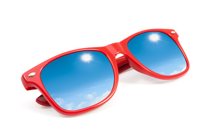 wayfarer: red sunglasses with sky and clouds in reflection isolated