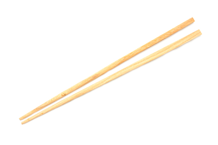 Wooden chopsticks on white background.