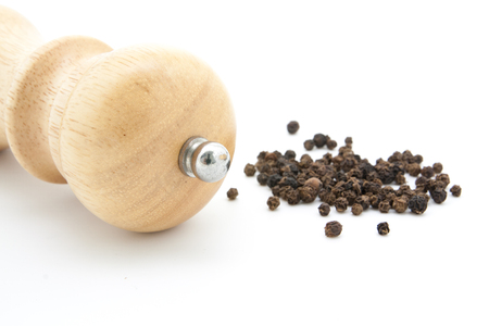 pepperbox: pepper mill of wood with ground pepper Stock Photo