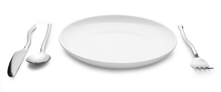 collation: place setting with plate knife fork and spoon on white