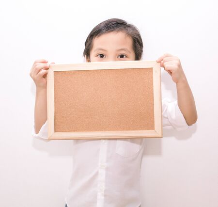 white poster: portrait of a little boy holding a board Stock Photo