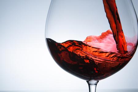 wine being pouring into a glass closeup wine splashing splash Stock Photo