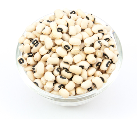 black eyed peas beans on wood cup isolated on a white background
