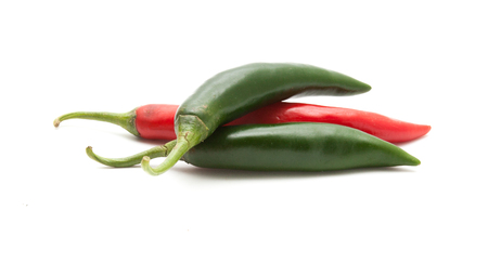 Red and green hot chili peppers isolated on white background closeup