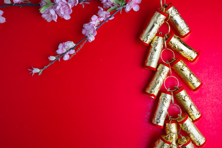 chinese new year festival decorations plum flowers on red  with copy space