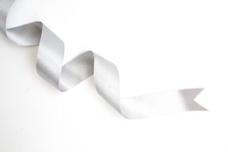 silver ribbon bow in bright silver white grey color isolated on white background
