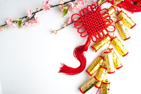 fire crackers: chinese new year festival decorations plum flowers on white with copy space Stock Photo