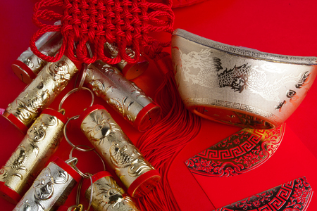 chinese new year festival decorations ang pow or red packe and gold ingots Stock Photo