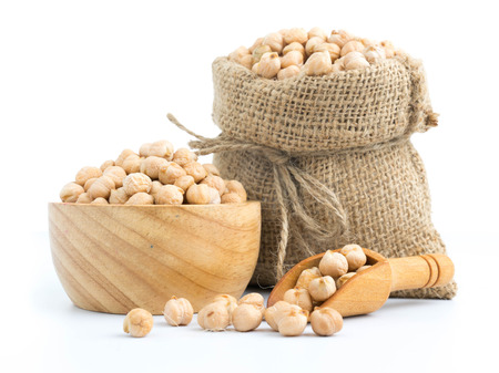 beautiful chickpeas on a bowl and sack vegetarian food on white
