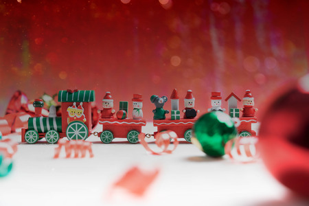 toy train on red bokeh background for christmas