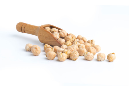 beautiful chickpeas on spoon isolated  top view on a white background