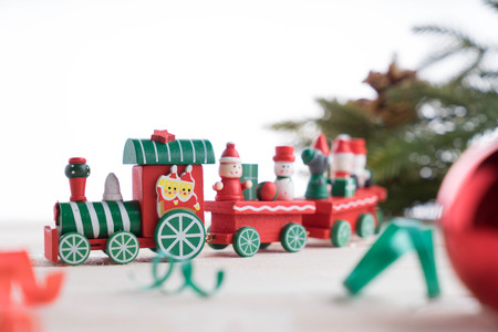 toy train on wooden background for christmas Stock Photo