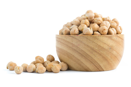 chickpeas in wood cup isolated on white background