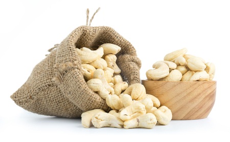 cashew nuts in burlap sack isolated on white background Imagens