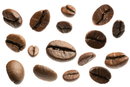 flying coffee beans isolated on white Stok Fotoğraf - 107909467