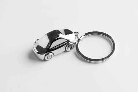 key chain in the form of a car isolated on white background Standard-Bild - 108542461