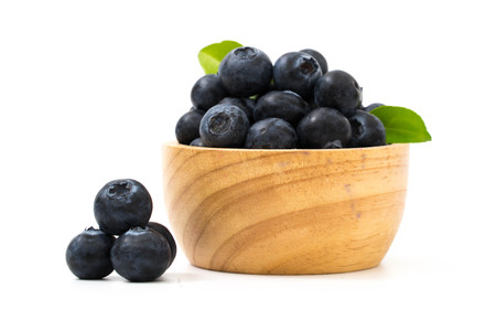 Blueberries on bow isolated on white Stock Photo