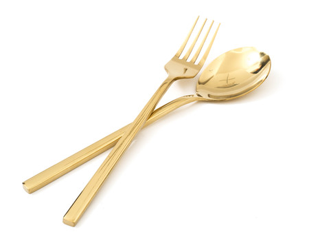Golden spoon and fork isolated on a white