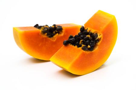 Slices of sweet papaya on white