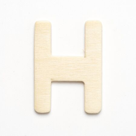 H wooden font letter on white blackground Standard-Bild