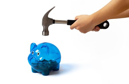 hand holding hammer smash  piggy bank on white background