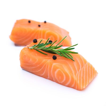 fresh raw salmon fillets with herbs and spice isolated on white background