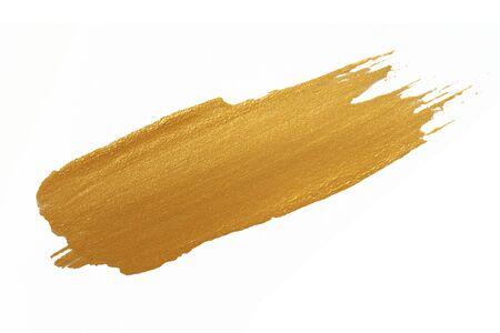 Tache de peinture de texture d'or sur le blanc