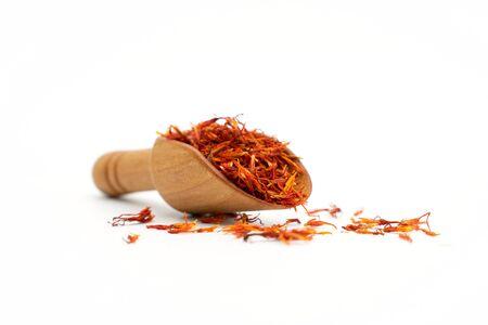 saffron spice wooden spoon on white background