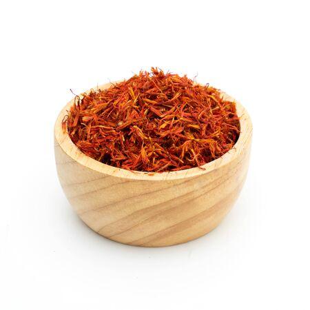 saffron spice wooden bowl on white background Standard-Bild