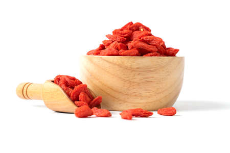 dried goji berries wooden bowl on white background