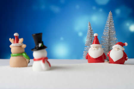 santa claus and snowman with snow background