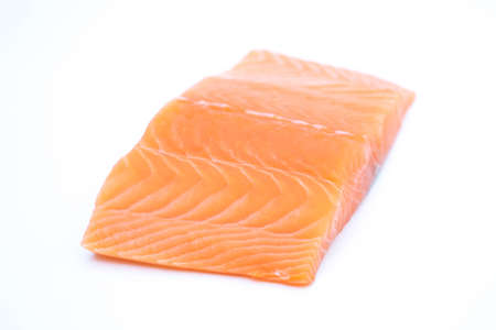 fresh raw salmon fillets isolated on white background