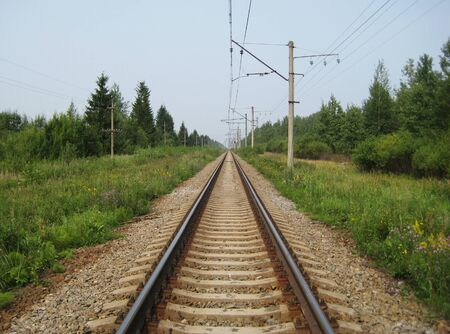 Train rail long straight track landscape during summer background