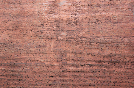 Old brick wall rustic texture background of grunge masonry house facade. Aged stone pattern on weathered pale surface with blank copy space