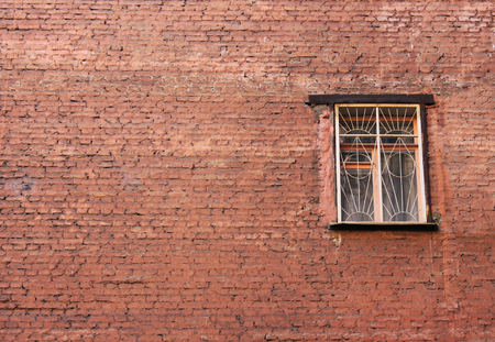 Window of old building facade. Brick wall background