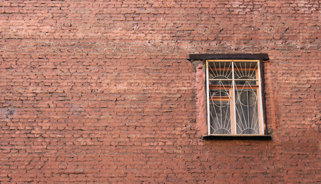 Building facade design. Factory house industrial alley view in suburbs. Classic window with grunge brickwall and bars