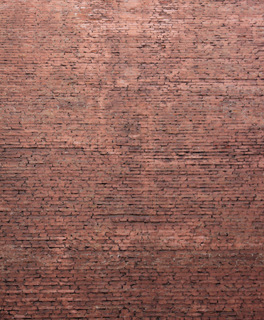 Red brick wall texture background of grunge masonry house front. Stone pattern on weathered brick wall surface with blank copy space