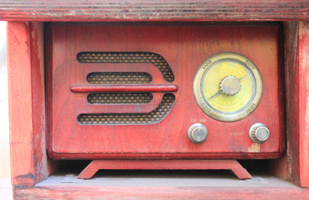 Old radio recorder in red wooden box. Vintage obsolete audio recorder and speaker Stock Photo