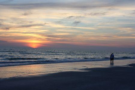 shores: Lovers on the beach at sunset, Redington Shores, FL, USA Stock Photo
