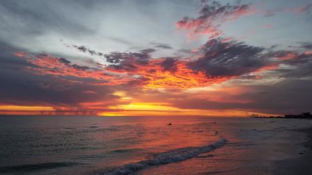 respite: Bright Orange Sunset Beach after storm