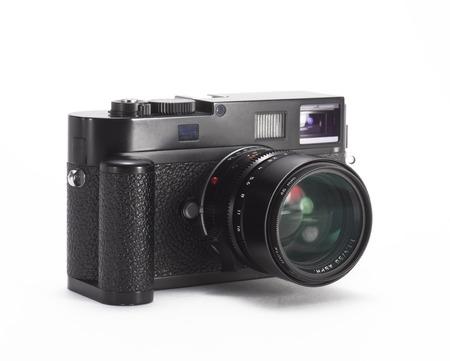 finder: black range finder camera with lens