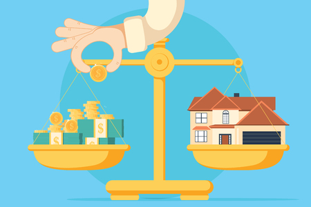 Scales with house and money. Buying a home.