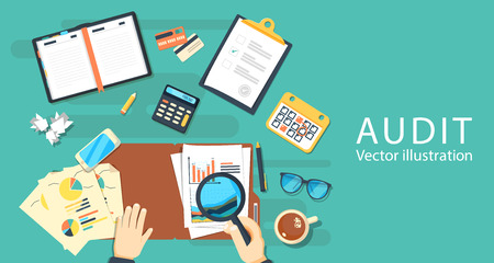 tax accountant: Auditing concepts. Auditor at table during examination of financial report.