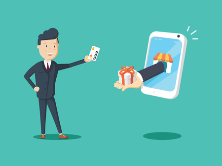 Happy businessman use credit card to shopping online and receive a gift box from smart phone.